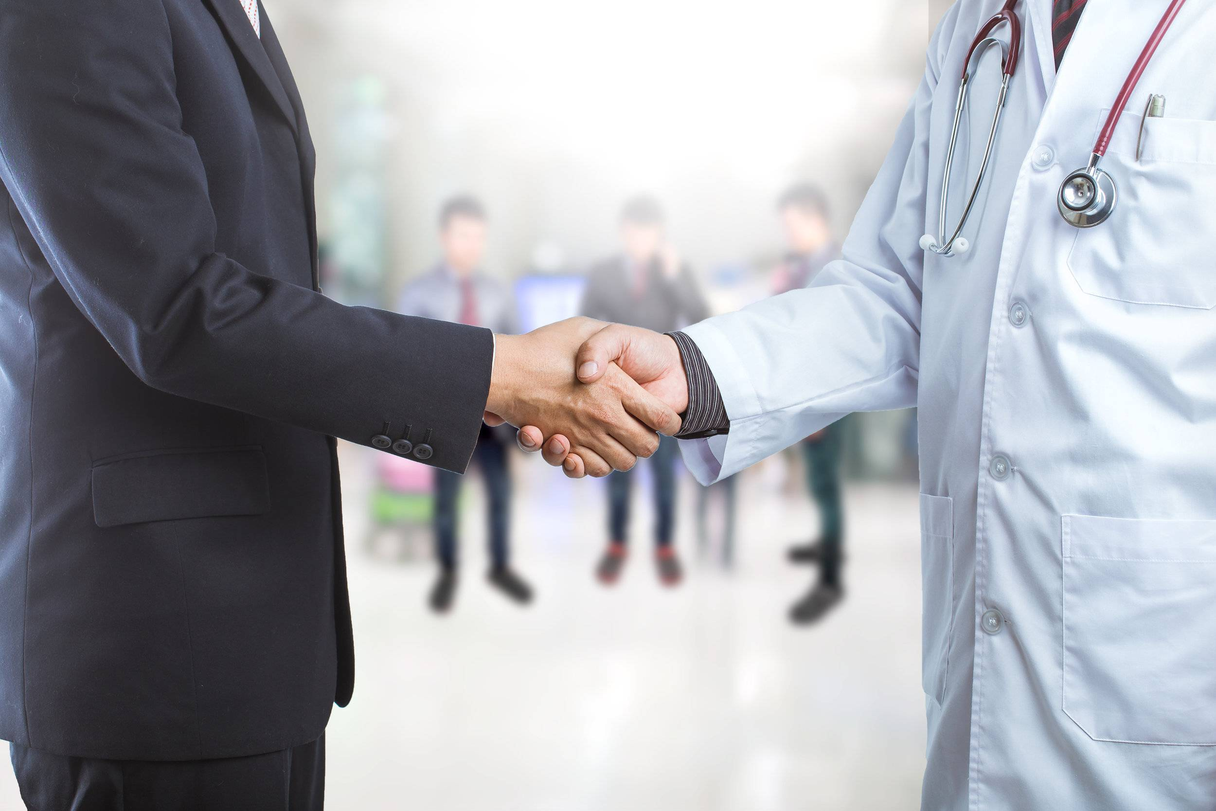 Businessman and doctor shaking hand's for some agreement